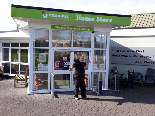 Tony, one of the formerly homeless people being supported by the charity, in front of the Emmaus Village Carlton Home Store