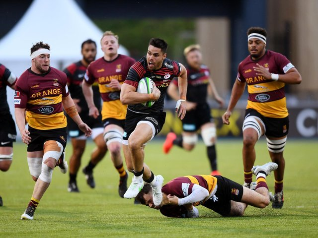 Ampthill in pursuit of Saracens' Sean Maitland in Monday's game (Picture Alex Davidson/Getty Images)