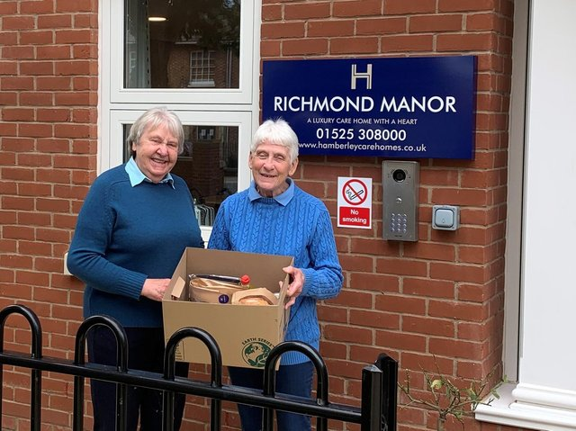 The food packages, including the delicious Richmond homemade bread, were picked up by Adela Walster, left and Stella Brooks