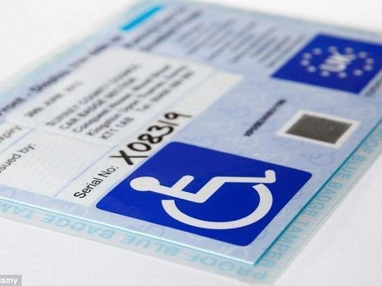 The Bedford Prison officer misused his wife's blue badge on two occasions
