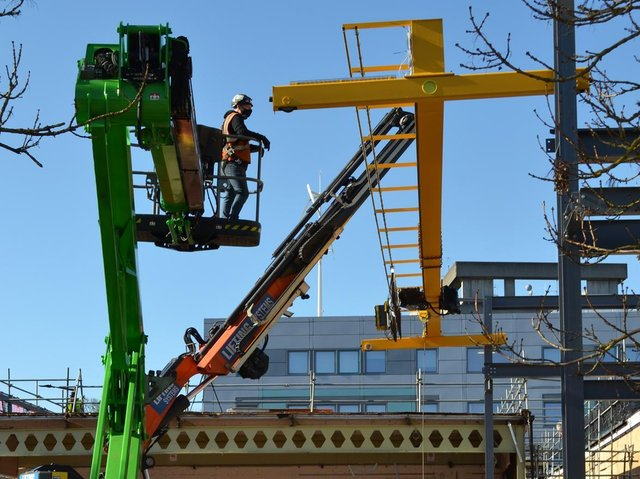 A gantry crane being moved into the newly refurbished block