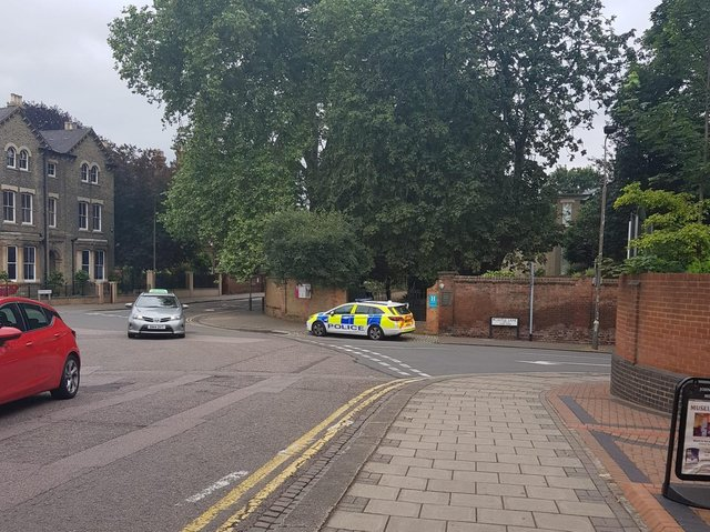 Police at Newnham Road today (Tuesday)